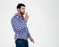 Handsome man showing gun gesture with fingers Stock Image