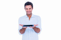 Handsome man showing his tablet computer Royalty Free Stock Image
