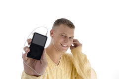 Handsome man showing ipod Stock Photo