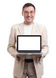 Handsome man showing laptop with blank screen Royalty Free Stock Images