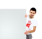 Handsome man showing  look out from white blank Royalty Free Stock Photos