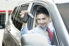 Handsome man showing new car key Stock Photography