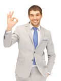 Handsome man showing ok sign. Bright picture of handsome man showing ok sign royalty free stock photo