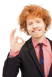 Handsome man showing ok sign Stock Photos