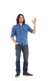 Handsome man showing OK sign Royalty Free Stock Photography