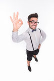 Handsome man showing okay sign in studio Stock Images