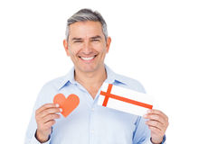 Handsome man showing present and paper heart Stock Photography