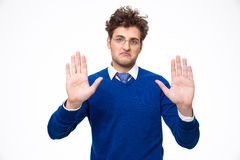Handsome man showing stop gesture Royalty Free Stock Photos