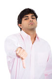Handsome man showing thumbs down sign Stock Photography