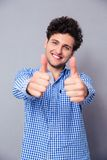 Handsome man showing thumbs up Stock Photo