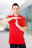 Handsome man showing time out sign Royalty Free Stock Image