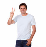 Handsome man showing victory sign with fingers Stock Photo