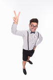 Handsome man showing yo sign in studio Stock Images