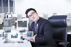 Handsome man shows financial graph Stock Photography