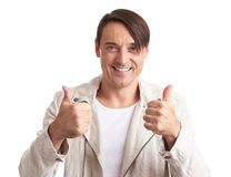 Handsome man shows his thumbs up royalty free stock images