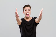 Handsome man singing emotionaly with closed eyes Royalty Free Stock Images