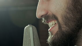 Handsome man singing with microphone stock video footage