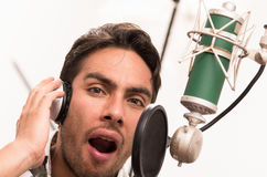 Handsome man singing in music studio Royalty Free Stock Photography