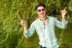Handsome man singing in the park Stock Images