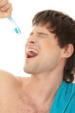 Handsome man singing to tooth brush Stock Photo