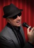 Handsome man singing Stock Images