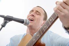 Handsome man singing Royalty Free Stock Image