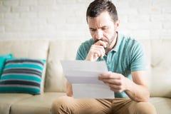 Latin man reading correspondence royalty free stock photos