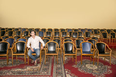 Handsome Man Sitting at the Audience Chair Alone Stock Image
