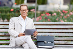 Handsome man sitting on the bench Stock Photos