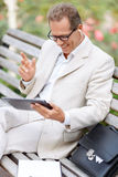 Handsome man sitting on the bench Royalty Free Stock Image