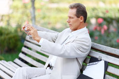 Handsome man sitting on the bench Royalty Free Stock Images