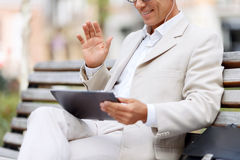 Handsome man sitting on the bench Stock Images