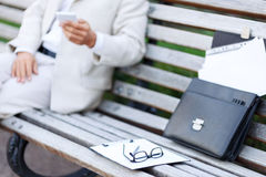 Handsome man sitting on the bench Royalty Free Stock Photography