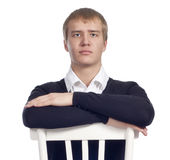 Handsome man sitting on the chair Royalty Free Stock Photos