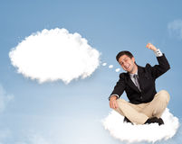 Handsome man sitting on cloud and thinking of abstract speech bu Stock Image