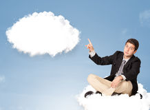 Handsome man sitting on cloud and thinking of abstract speech bu Royalty Free Stock Images