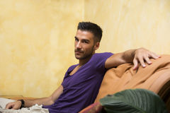 Handsome man sitting on couch Royalty Free Stock Photos