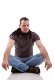 Handsome man, sitting on the floor Royalty Free Stock Photo
