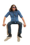 Handsome man sitting and laughing Stock Images