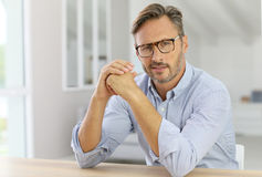 Handsome man sitting at office desk Royalty Free Stock Photography