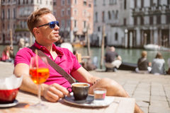 Handsome man sitting in outdoor cafe Royalty Free Stock Photos