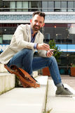 Handsome man sitting outdoors on steps. Portrait of handsome man sitting outdoors on steps Royalty Free Stock Image