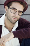 Handsome man sitting outdoors royalty free stock image