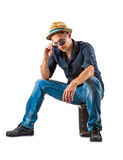 Handsome man sitting on white background Royalty Free Stock Photos