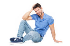 Handsome man sitting Stock Photos