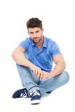 Handsome man sitting Stock Images