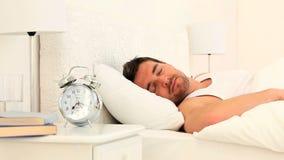 Handsome man sleeping stock footage