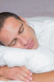 Handsome man sleeping on his pillow Royalty Free Stock Photos