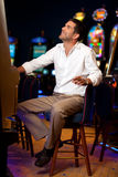 Handsome man at the slot machine Royalty Free Stock Photography