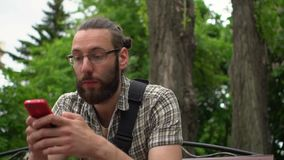 Handsome man with smartphone stock video footage